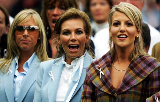 Alison McGinley reacts as Caroline Harrington (L) and Henrik Stenson's girlfriend Emma Lofgren (R) look on during the Opening Ceremony of the 2006 Ryder Cup at The K Club on September 21, 2006 in Straffan, Co. Kildare, Ireland