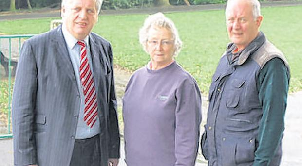 MP for South Belfast, Dr Alasdair McDonnell, and Mr Gerald and Patricia Kelly of the Four Winds Residents' Association stand at the site of the proposed community centre