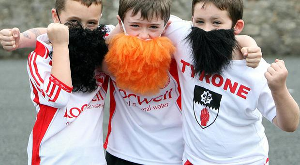 Hair we go, hair we go: Nathan McNamee, Mark Corry and Oran Meenagh from St Colmcille's primary school in Omagh.