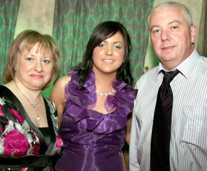Father of three Eamonn Hughes pictured with his wife and daughter at her birthday party just an hour before he was stabbed to death in Dungannon, County Tyrone