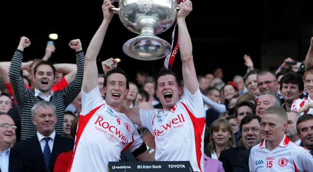 Tyrone brothers Colm and Sean Cavanagh lift the Sam Maguire