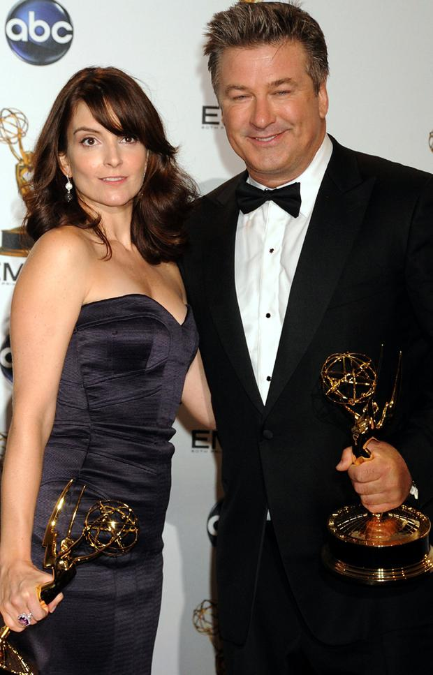 Actress Tina Fey and Alec Baldwin with their awards at the 60th Primetime Emmy Awards