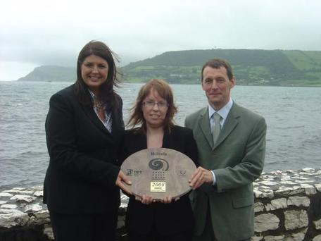 Gillian McBrien (Coca Cola Bottlers Ulster Ltd), Emma Rollins (Ards Borough Council), Ian Humphreys (CEO TIDY Northern Ireland) with the Green Coast Award for Millisle Beach Park