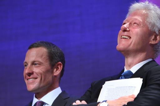 Former U.S. President Bill Clinton stands with Lance Armstrong during the opening session of the Clinton Global Initiative (CGI) September 24, 2008 in New York City