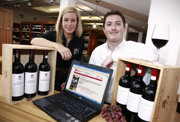 Lucinda McMillan and Daren Rafferty from James Nicholson Wine Merchant unveil the company's new website, JNwine.com, as Lucinda celebrates being appointed the Comber business' new trainee