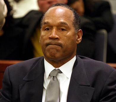 OJ Simpson reacts as he is found guilty on all 12 charges, including felony kidnapping, armed robbery and conspiracy at the Clark County Regional Justice Center on October 3, 2008 in Las Vegas