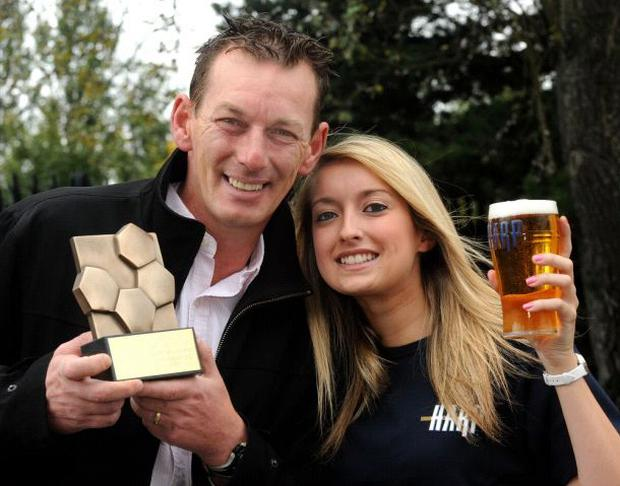 Glentoran boss Alan McDonald receives the Harp Lager Northern Ireland Football Writer's Manager of the Month award from Harp girl Caroline Reid