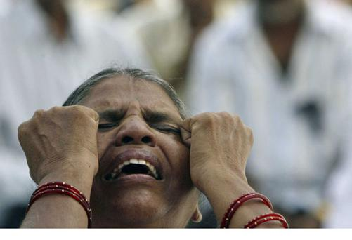 A woman shows her grief at the religious violence in Orissa during a gospel hymn service