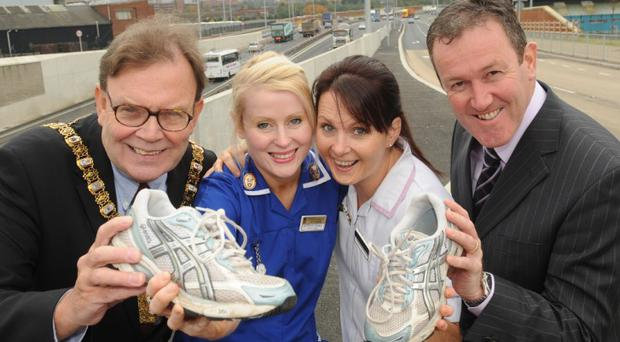 Race to mark end of M1 roadworks(L-r) Lord Mayor of Belfast Tom Hartley, Kathryn Shaw and Mary Rose Scott from the NI Hospice and Roads Minister Conor Murphy at the launch of the 'Between the Bridges' run run and charity race this week. Photo by Simon Graham/Harrison Photography