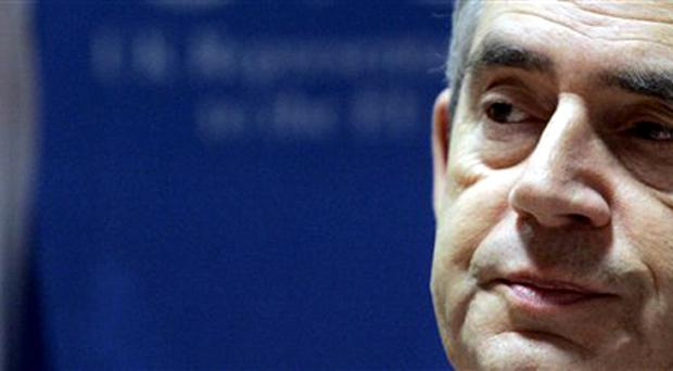 Prime Minister Gordon Brown listens to questions after an EU summit in Brussels