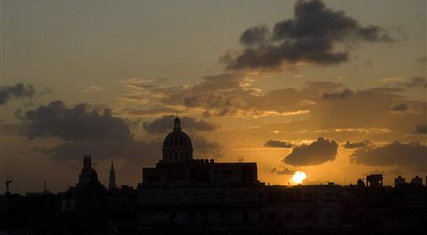 The Capitol building is seen during the sunset in Havana, Thursday, Oct .16, 2008. (AP Photo/Ramon Espinosa)