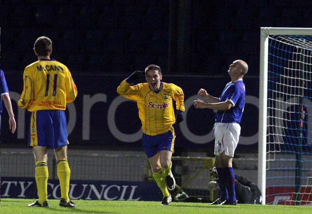 Dungannon Swifts ace Ryan Mullan runs off to celebrate after finding the back of the Linfield net during the Co-Operative Insurance Cup first leg clash last night