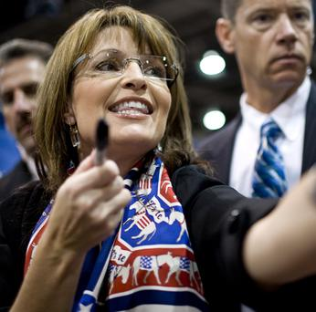 Hee haw: Sarah Palin is seen wearing a scarf emblazoned with donkeys at a rally in Nevada. The donkey has become the established political symbol for the Democratic Party