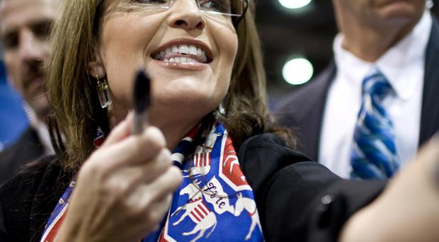 Sarah Palin is seen wearing a scarf emblazoned with donkeys at a rally in Nevada. The donkey has become the established political symbol for the Democratic Party