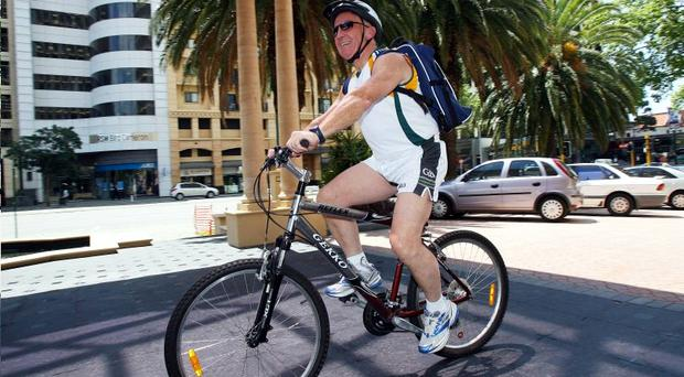 Ireland team manager Sean Boylan returns from a cycle around Perth after attending a press conference at the Subiaco Oval ahead of today's International Rules Series clash with Australia
