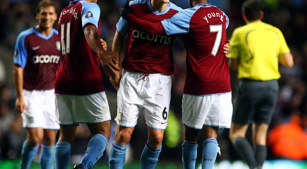 Gareth Barry of Aston Villa celebrates scoring the second goal with Luke Young and Gabriel Agbonlahor during the UEFA Cup Group E match between Aston Villa and Ajax at Villa Park