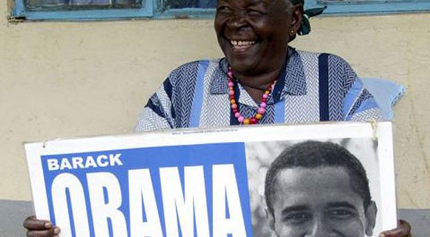 Sarah Onyango Obama, 86, who raised Mr Obama's father, at her home in Kogelo, Kenya. Her television is solar-powered because there is no electricity in her village