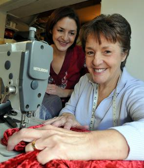 Mum and daughter combination Sally and Claire Heaney get going on the sewing machine at their workshop in Derry