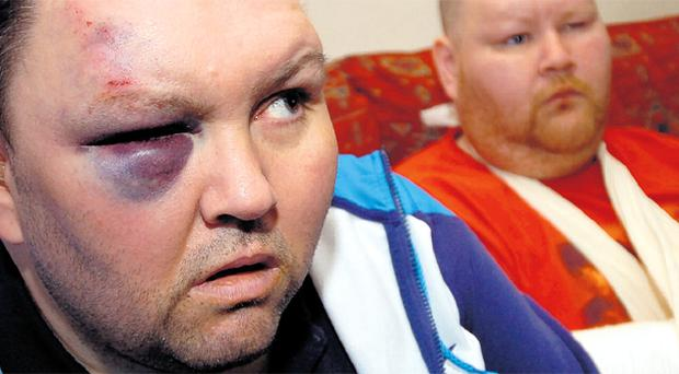 Terrifying ordeal: Whiteabbey brothers Stephen (left) and George Sloan were attacked in the home for £20