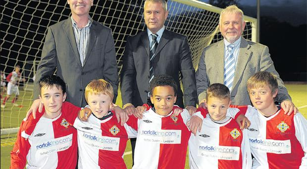 Derry City manager Stephen Kenny,(back left) is pictured with Norfolklines business development manager Don Clarke and IFA director of coaching Roy Millar with five of the young Derry boys who are benefitting from using the County's football Excellence Centre.