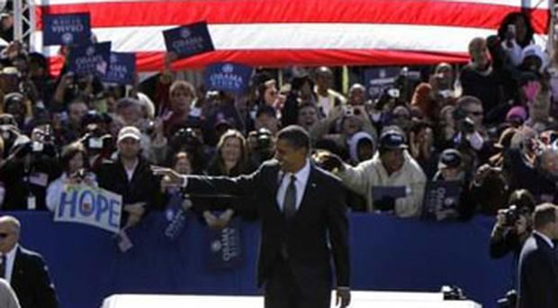 An upbeat Senator Obama greets supporters at Halifax Mall in Raleigh, North Carolina, yesterday