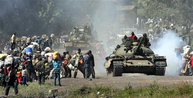 Congolese tanks and thousands of displaced people stream into Goma in eastern Congo