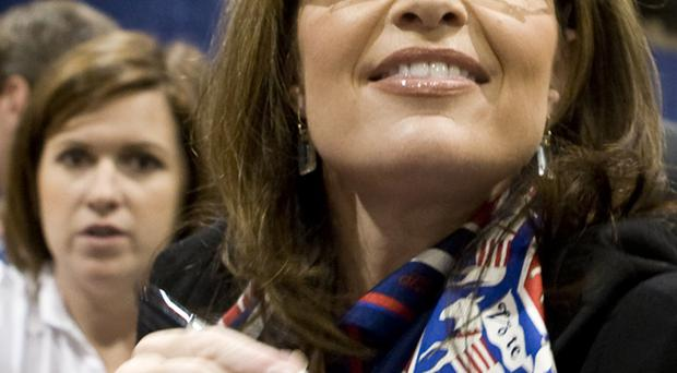Donkey wrong: Sarah Palin is seen wearing a scarf emblazoned with donkeys at a rally in Nevada on Tuesday. The donkey has become the established political symbol for the Democratic Party