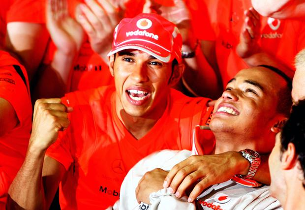 Formula 1 champion Lewis Hamilton celebrates with his brother Nick after sealing the title in Brazil
