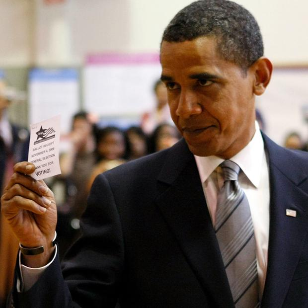 Democratic presidential nominee U.S. Sen. Barack Obama (D-IL) shows off a voter validation slip on election day after voting November 4, 2008 in Chicago, Illinois.