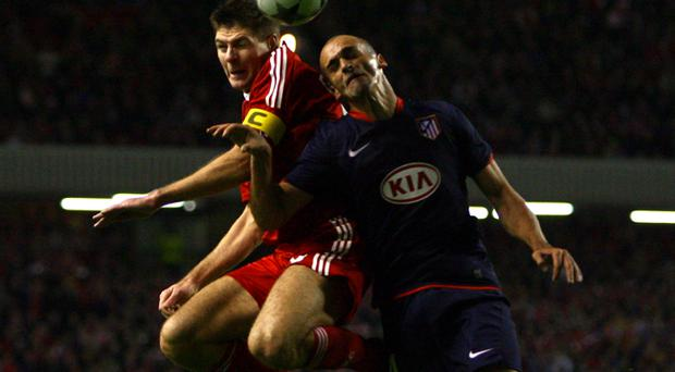 Steven Gerrard won a penalty for Liverpool after a challenge by Athletico Madrid's Mariano Pernia