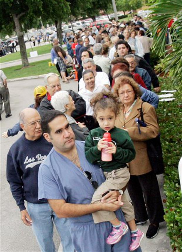 Residents wait in line to cast their votes in Hialeah, Fla., Tuesday, Nov. 4, 2008. Long lines are already forming outside precincts as polls opened at 7 a.m. in this contentious swing state that could come down to a handful of votes. (AP Photo/Alan Diaz)