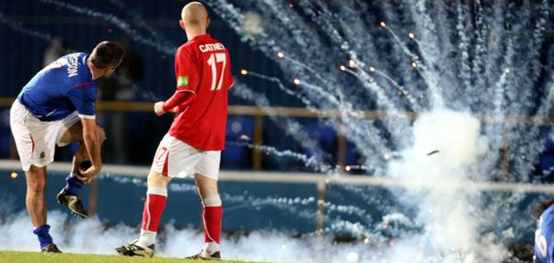 Fireworks explode on the pitch during the County Antrim Shield Final