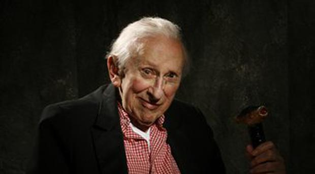 **FILE** In this Sept. 18, 2007 file photo from the Chicago Tribune, Author Studs Terkel poses in Chicago. Terkel, the ageless master of listening and speaking, a broadcaster, activist and Pulitzer Prize-winning author whose best-selling oral histories celebrated the common people he liked to call the
