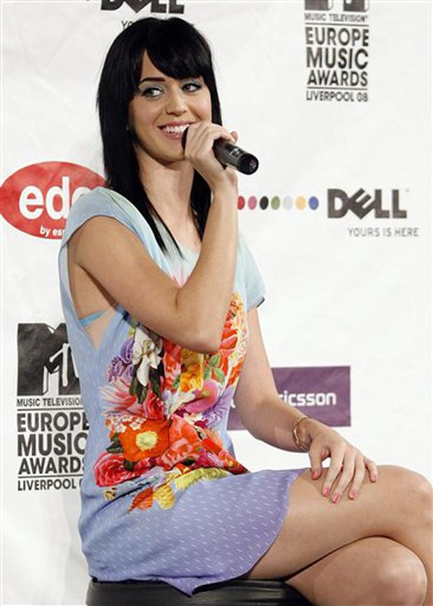 U.S. singer Katy Perry speaks during a media conference ahead of the 2008 MTV Europe Music Awards this Thursday at St George's Hall, Liverpool, England, Wednesday Nov. 5, 2008. (AP Photo/Paul Thomas)