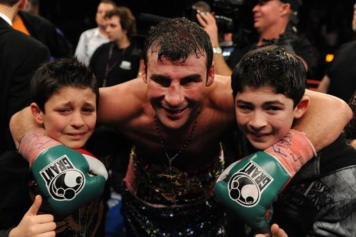 Joe Calzaghe celebrates his victory over Roy Jones Jr with his two sons, Connor (L) and Joe (R) during their Ring Magazine Light Heavyweight Championship bout at Madison Square Garden November 8, 2008 in New York City