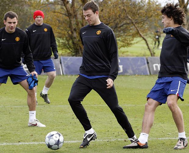Jonny Evans (centre) trains with his Manchester United team-mates