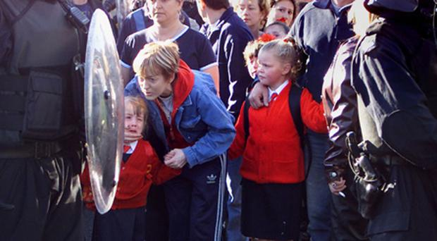 Images from the loyalist blockade of Holy Cross Primary School in 2001