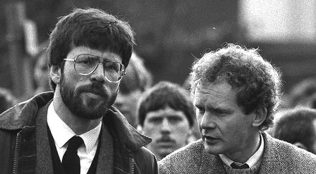 President of Sinn Fein Gerry Adams and Martin McGuinness at the funeral of Patrick Kelly . 1987