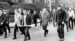 MOURNERS CARRYING HURLING STICKS HEAD THE FUNERAL PROCESSION OF JOHN JOSEPH KAVANAGH, FOUND SHOT DEAD IN THE RIVER BLACKSTAFF. 27.01.1971.