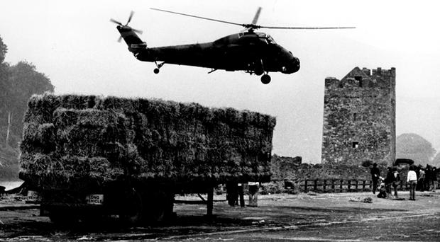 Warrenpoint (Narrow Water Castle) where 18 soldiers were killed 27/8/1979. A grim reconstruction of the scene at narrow water, Warrenpoint. An Army helicopter flies in past a replica of the hay lorry which hid the first bomb. 31/8/1979.