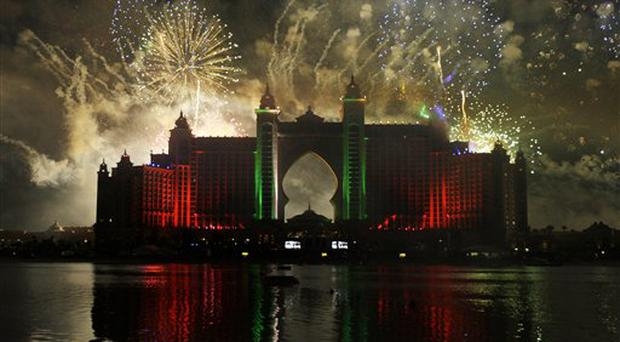 A general view of the fireworks at the Atlantis resort in Dubai, Thursday, Nov. 20, 2008. While the rest of the world is tightening its belt, Dubai is throwing a US$20 million party Thursday complete with Hollywood celebrities and a fireworks show that organizers said would be visible from outer space. The party, which will be headlined by Australian pop star Kylie Minogue in her Middle East debut, is to celebrate a new US$1.5 billion marine-themed resort built off the Gulf coast on an artificial island in the shape of a palm tree. (AP Photo/Joel Ryan)