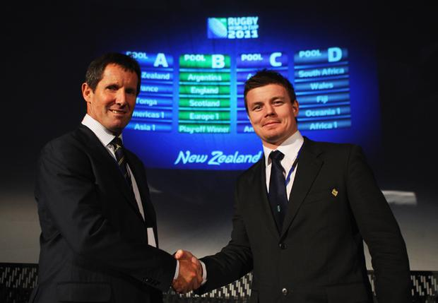 Australia coach Robbie Deans (left) shakes hands with Ireland captain Brian O'Driscoll after the draw for the 2011 IRB World Cup