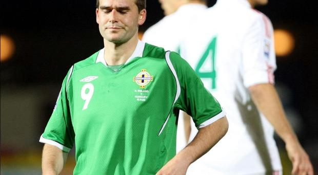 David Healy shows his disappointment after Northern Ireland's defeat to Hungary at Windsor Park. Healy says manager Nigel Worthington was critical of players following the game
