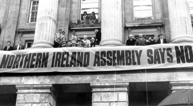 Loyalist Anglo Irish Agreement Protest Rally outside Belfast City Hall, with Unionists showing a united front. 10/12/1985
