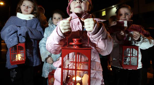 Children from the Suffolk estate and Lenadoon gather for their Christmas service