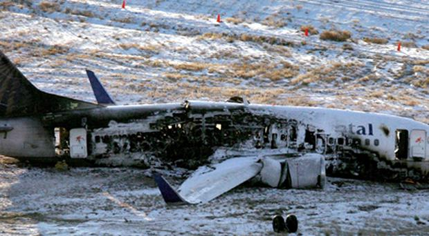 The wreckage of a 737 Continental plane sits at Denver International Airport on Sunday, Dec. 21, 2008.