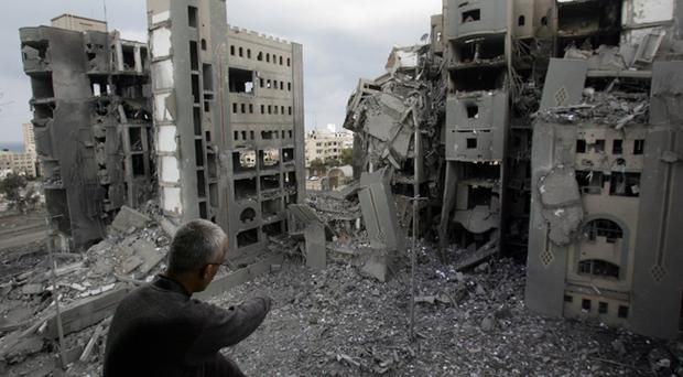 A Palestinian man looks at the destruction from his damaged home on December 30, 2008 in Gaza City