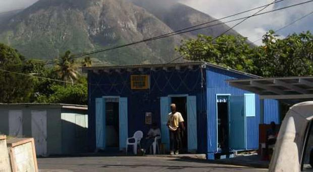 Heat and dust: a volcano looms over a traditional Montserrat house