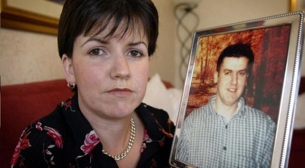 Diane Hamill with a picture of her murdered brother Robert Hamill, who was beaten to death in a sectarian attack in Portadown in 1997