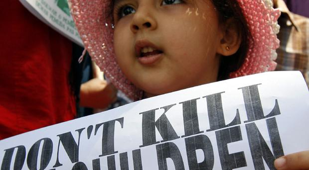 A Children hold a banner reading,